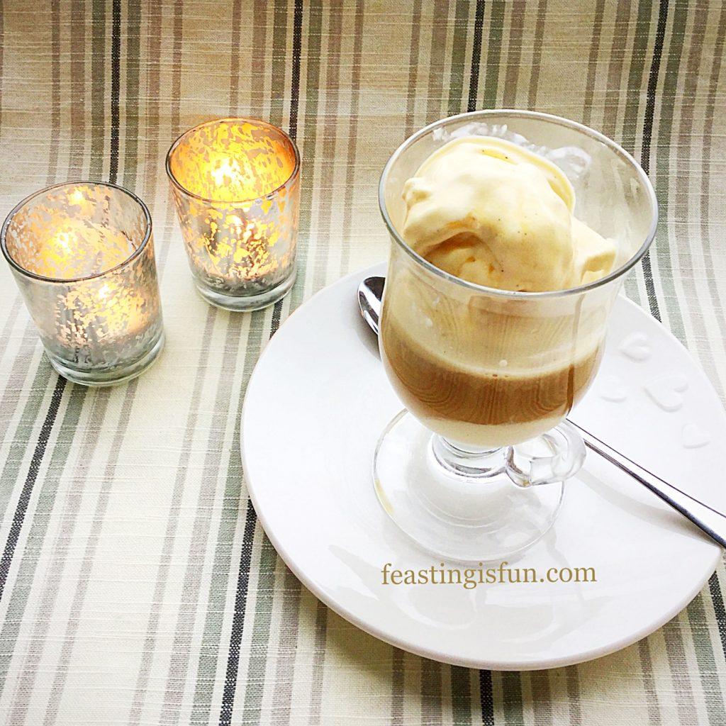 Affogato dessert made using Amaretto Creamy Ice Cream and freshly brewed coffee, served in a glass mug.