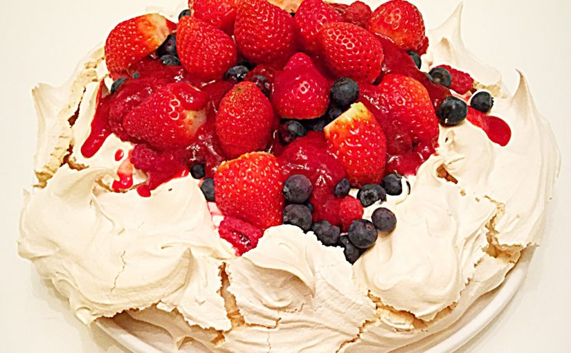 Raspberry Coulis Drizzled Mixed Berry Pavlova