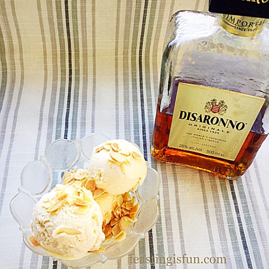 Almond liqueur bottle alongside a bowl of frozen dessert made use the liqueur.