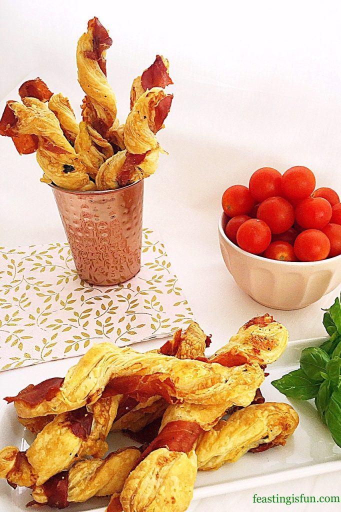 Savoury food snacks displayed on a platter and in a copper cup.