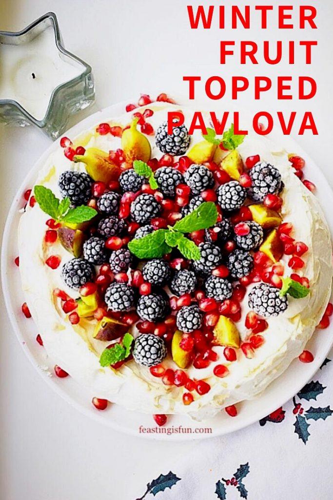 Frozen berry topped meringue dessert.