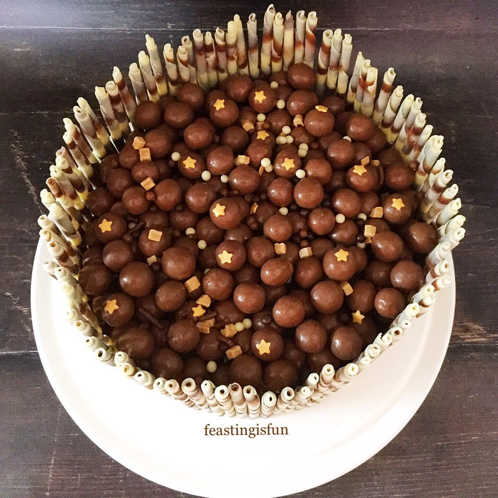 Overhead photo of a special party bake, showing Maltesers mixed with star sprinkles.