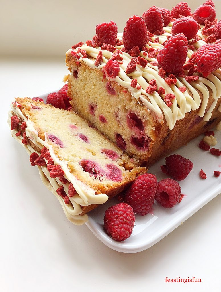 Sliced raspberry and white chocolate loaf cake.